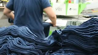 Sneak peek of our production guys printing t-shirts