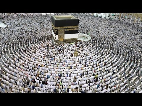 Thousands of Muslim worshippers perform prayers around the Kaaba