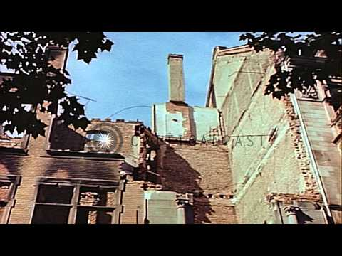 Damaged and ruined buildings are demolished in Leipzig after Allied forces take c...HD Stock Footage