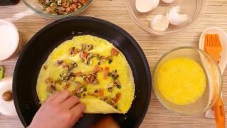 Яичный рулет (омлет) с грибами, помидорами и сыром