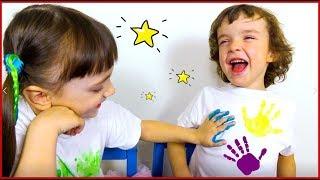 Makar and Ksenia paint t-shirts