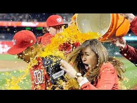 Hot reporter Julie Alexandria gets a surprise Gatorade shower. FUNNY Prank