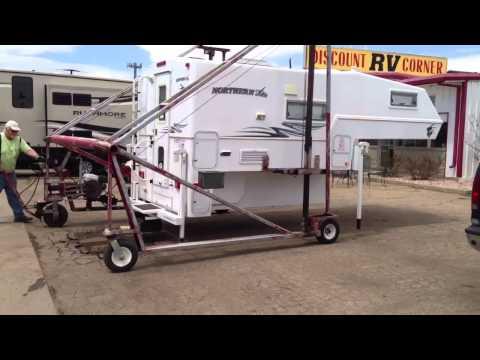 Truck camper hoist