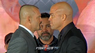 CHUCK LIDDELL SMILES AT TITO ORTIZ DURING INTENSE FACE OFF AT FINAL PRESS CONFERENCE