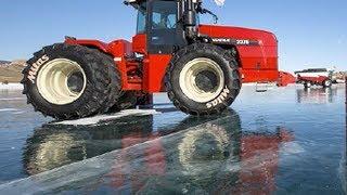 Tractor &amp Harvester ice skating on Lake Baikal