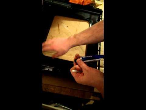 Re-sealing oven door glass.