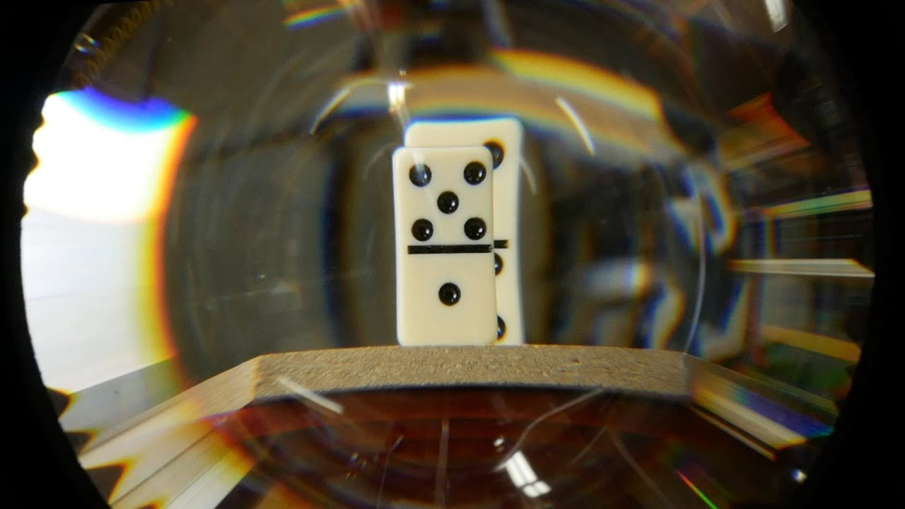 Hypercentric optics: A camera lens that can see behind objects