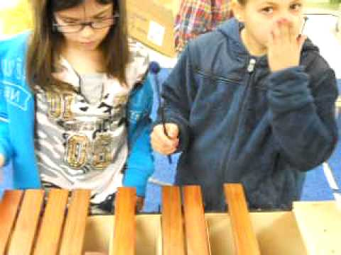 Colt Andrews School students play on xylophones