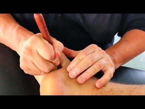 Foot massage with massage tools. Foot reflexology. Deep tissue foot massage.Brandon working Skyler 5