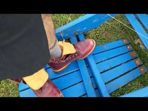 Dismantling And Burning A Wooden Adirondack Chair Wearing Hot Beat Timberland Boots-1