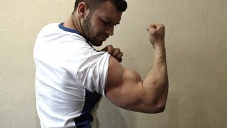GIANT PUMPED BICEPS RIPS SHIRT OFF