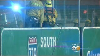 Man jumps from freeway overpass