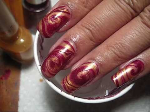 red & gold swirl water marble