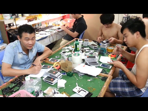 Chinese Dudes Refurbishing Smartphones in a China Shop