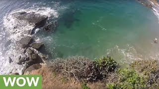 Daredevil jumps cliff into shallow water from terrifying height