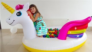 Ksysha Plays with Unicorns Inflatable Toy and Pool with Toys