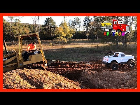 Mini Monster Truck Pulling The Stuck Track Loader