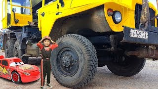 Mcqueen Boy Helping To Bear With Truck