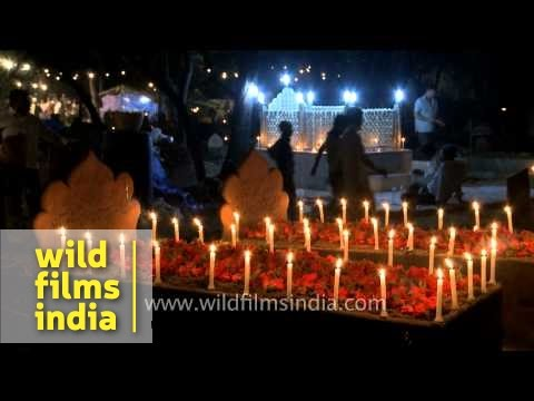 Muslim people light candles on the graves of their loved ones - Shab-e-barat