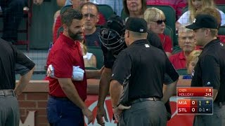 Home-plate umpire Chad Fairchild is hit by a foul ball on the right...