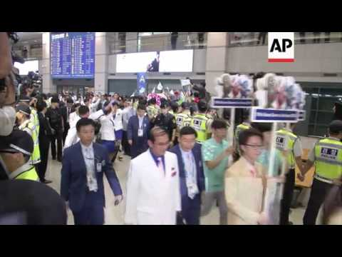 North Korean athletes and their support teams arrive ahead of the 2014 Asian Games