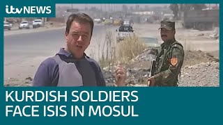 Kurdish soldiers face ISIS militants across 'No Man's Land' in Mosul, Iraq | ITV News