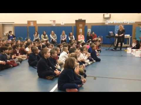 K-2 students at Overbrook School in East Haven use buckets as instruments during as assembly about k