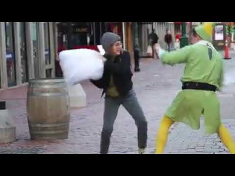 Kristina Kage - Firefighter dressed as Buddy the Elf challenges strangers to pillow fights
