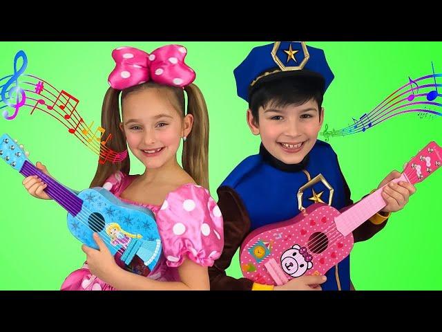 Sasha plays Toy Guitar Music Challenge and sing Kids Nursery rhymes Songs