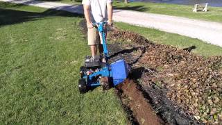 How to edge garden beds with a Bluebird Bed Bug Landscape Edger in New Oxford PA -Ryan's Landscaping