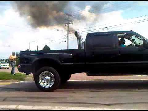jacked up dually burnin rubber - YouTube
