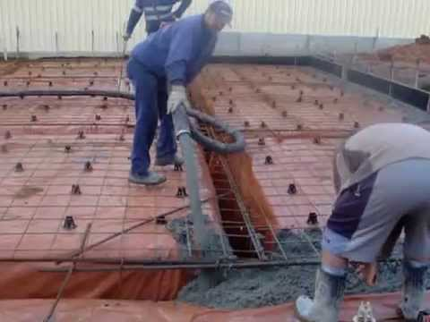 Making a concrete slab, house foundation. Pouring cement.