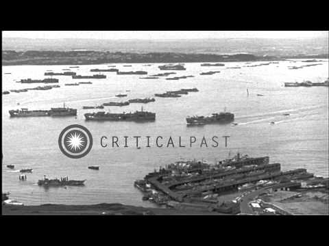 Ships and invasion craft  anchored in  Portland harbor, England, during World War...HD Stock Footage