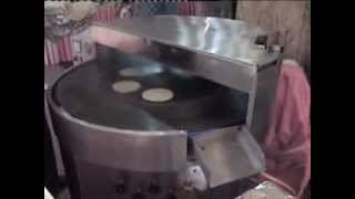 SEMI BAKED PUROTI PARANTHA BAKING MACHINE MADE BY PURE DAIRY FARM PRODUCTS INDIA