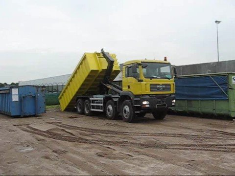 Hyvalift 40 Tons Hookloader on MAN TGA 8x4 lifting a heavy container