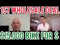 How to get your first real estate wholesale deal | $15,000 from biking for dollars interview