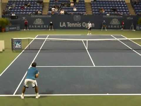 Michael Chang gets taken down the line by Jim Courier