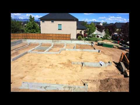 Filling in foundation, compacting, leveling