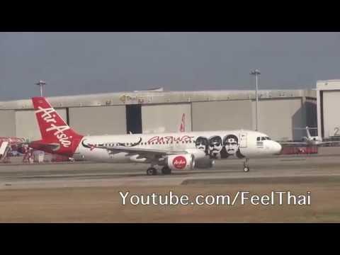 เครื่องไทยแอร์เอเชียบินขึ้นจากดอนเมือง Thai Air Asia airbus taking off from Bangkok DMK airport