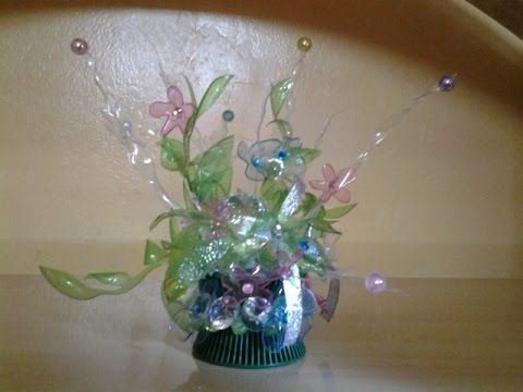 Best out of waste plastic transparent bottles converted to fleur transparente showpiece youtube for Best out of waste models
