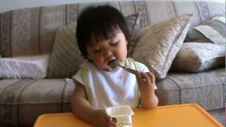 my baby eating yogurt