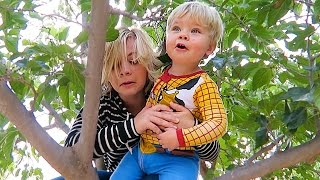 TODDLER TRAPPED IN TREE!