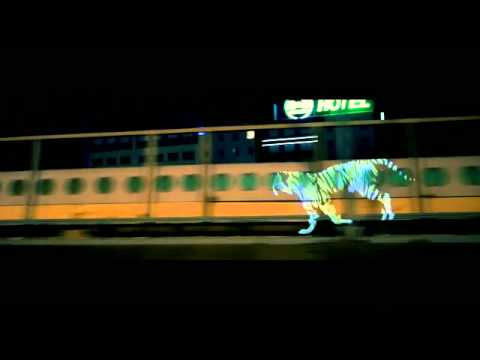 3D Projected Tiger Runs Through The Streets Of Paris