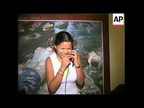 Relatives of Hugo Chavez await news at family home