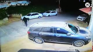 Security footage of assailants slashing tires of cars in West Bank village of Marda