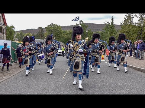 RAF Central Scotland Pipes & Drums parade through village to 2018 Braemar Gathering Highland Games