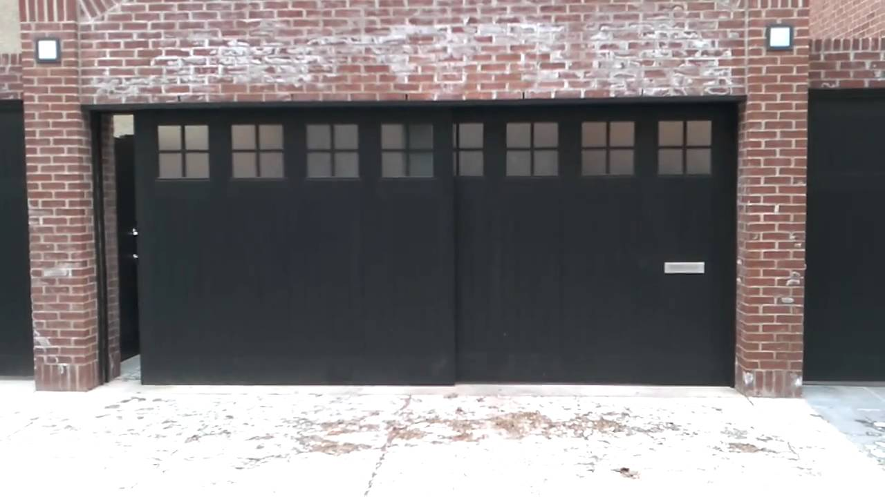 Sliding garage door youtube for Entrance doors for sale