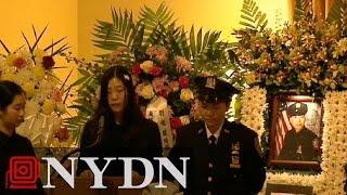 Pei Xia Chen, wife of slain NYPD officer Wenjian Liu pays final respects