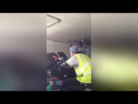 Baggage handler caught stealing from luggage in Thailand