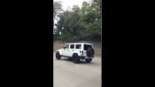 Custom Lifted White Jeep On Highway